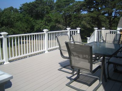 Large Deck Overlooking Backyard with Stainless Steel Grill