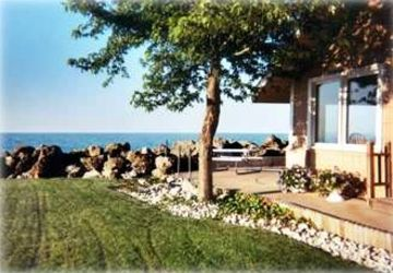 Port Clinton house rental - Golden Gate Cottage sits VERY close to Lake Erie. Lawn beside our beach.