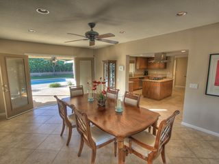 Palm Desert house photo - Formal dining room with French doors to pool.