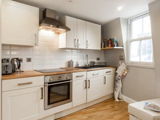 Islington apartment photo - Cook at home! Fully equipped kitchen with fridge-freezer, washing machine