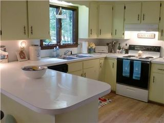 Pocasset house photo - Bright and cheerful kitchen with laundry area