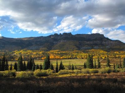 A view from across the Rio Grande looking back at Lost Trail Ranch in autumn.