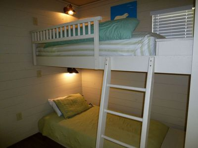 Hallway bunks outside bunk guest room, with reading lights