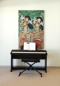 A piano keyboard offers entertainment in the living room