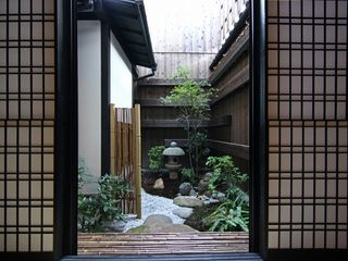 Tsuboniwa is one of the features of Machiya that introduces a sense of nature. - Kyoto townhome vacation rental photo