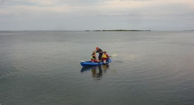 Family having fun in kayak. Kayak rental available!