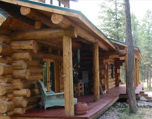 Whitefish cabin photo - Beautiful log construction with deck all around