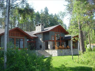 Lake side of custom craftsman home, 50' from the shores of lovely Flathead Lake.