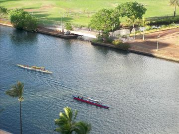 Enjoy the Peaceful Serene View of Ala Wai Canal as the Canoe Paddlers Pass By...