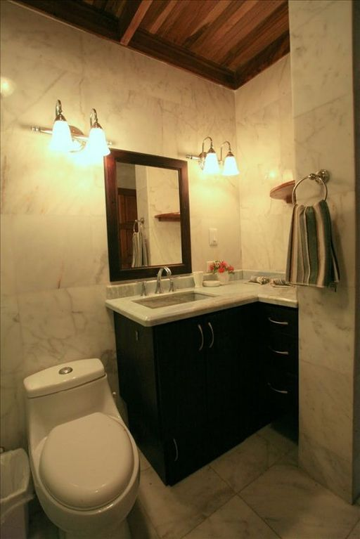 White Marble bathrooms with blue topaz counter tops.