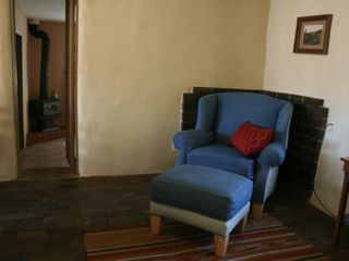 Santa Fe cottage photo - Armchair and doorway to master bedroom