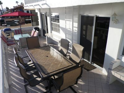 Las Gaviotas house rental - Our 2nd floor patio has two patio tables with seating for 12 people.