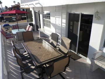 Our 2nd floor patio has two patio tables with seating for 12 people.