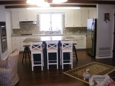 Well appointed kitchen with large center island with seating for 6
