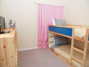 Third bedroom with bunk beds, tv and dvd player.