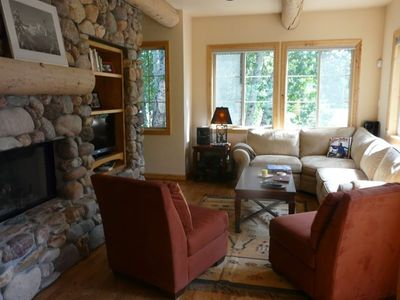 Stone fireplace offers lots of warmth for watching movies..