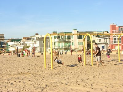 Swing set on beach by condo