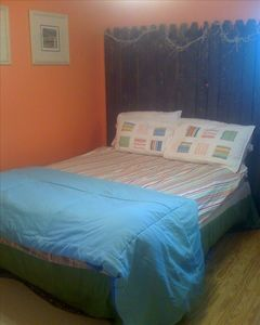 bedroom with old fence headboard.