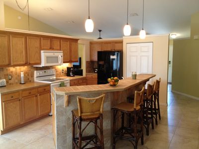 Great room area includes a large kitchen, plenty of counter space and b'fast bar