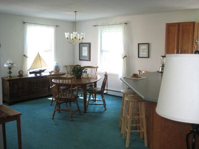 On entering, find spacious, bright, open floor plan. Dining table seats 4 to 8