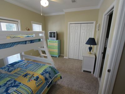 The third bedroom with a twin over a full bed. Features a private bath.