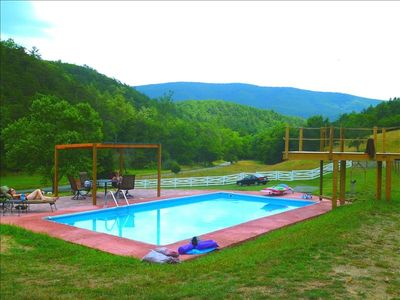 Pool, jumping platform, and countryside.