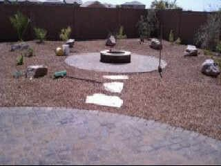 Newly landscaped back yard firepit