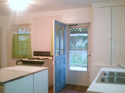 Kitchen door leads to the covered patio