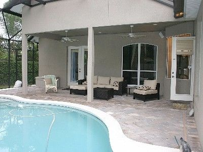 Screened in pool patio with lighting and outdoor speakers.