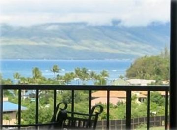 Kihei condo rental - Wrought iron patio furniture overlooking the ocean and West Maui Mountains
