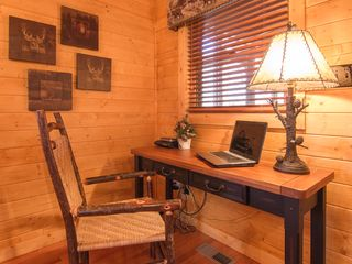 Pigeon Forge cabin photo - computer table set up with WIFI looking out over screened in porch with hot tub