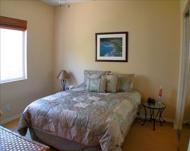 The Third bedroom is warm and inviting with your own lava lamp--