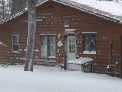 Minocqua cabin rental - Winter at Black's Cliff getting snowed in by the fireplace