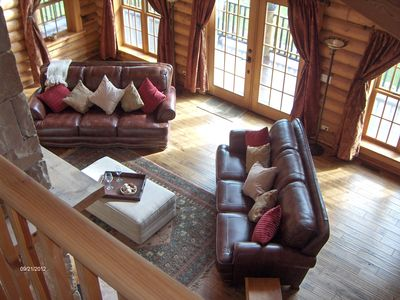 Great room (oak floors and leather sofas) and balcony from minstrel's gallery
