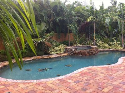 Gorgeous heated swimming pool and spa tucked away in lush tropical garden.