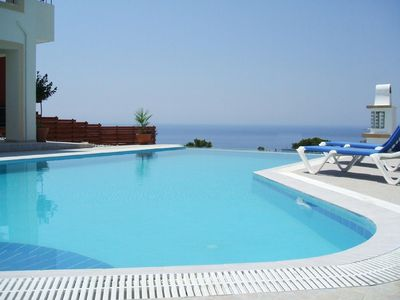 Pefkos villa rental - luxury, large, shaped 5* infinity pool