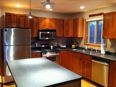 Gourmet kitchen with stainless and granite for creating special dinners