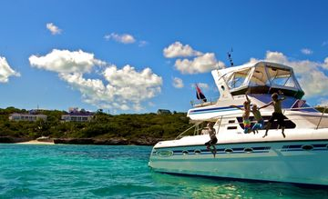 Take a private charter for the day, Azure Villa in the background