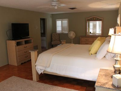 Master Bedroom with TV, master bath & walk-in closet.