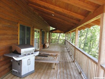 Large grill and picnic table on the upper deck.