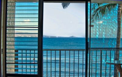 Looking at the ocean through front sliding doors onto our lanai.