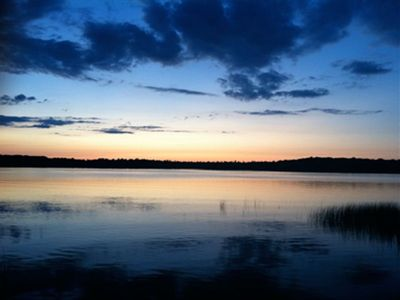 Interlochen cottage rental - Just after sunset from InterlochenCabinRental's boathouse deck