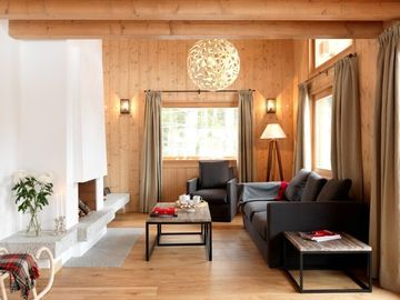 Chalet des Liarets 4 Living area with open fire