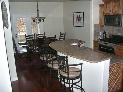 Wilson townhome rental - Kitchen Island and Dinning Area.
