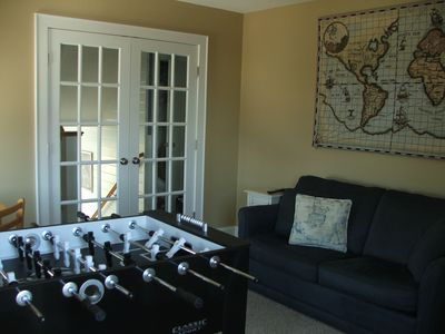 foosball for the kids and a wet bar for the adults in the game room