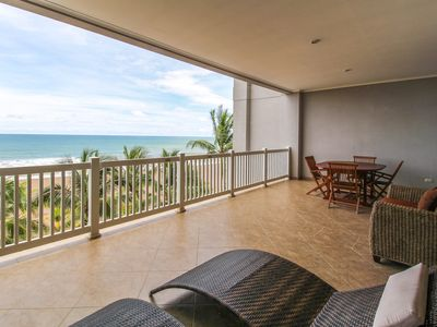 Oceanfront getaway with sweeping sea views & shared pool access