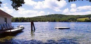 Waterfront with swim raft and diving board - Center Harbor cottage vacation rental photo