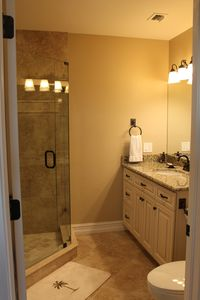 Master Bath with seamless glass shower and granite counter tops