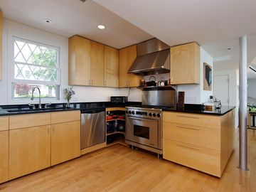Gourmet Kitchen w/ lge island for prep, buffet & dining. Upstairs 4BRs & 2 Bths.