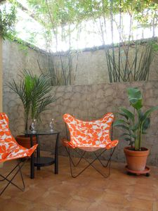 St. Croix condo rental - welcome area patio with bamboo trees for shade